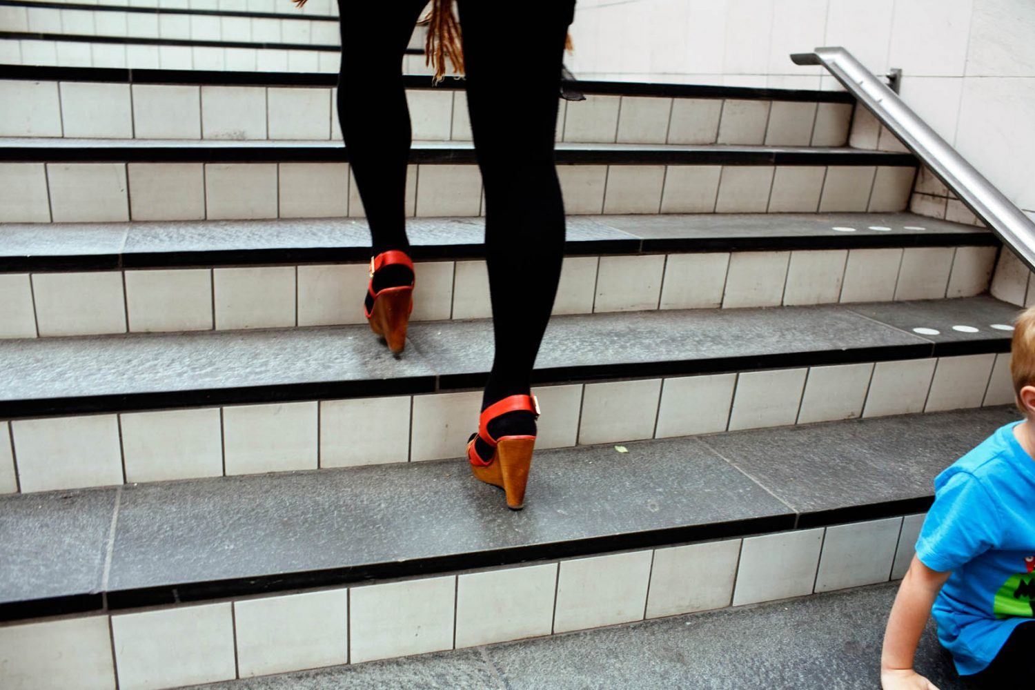 Nederland, Amsterdam, 22-06-2011 Beautiful woman legs running up the stairs at Amstelstation in Amsterdam PHOTO AND COPYRIGHT ROGER CREMERS