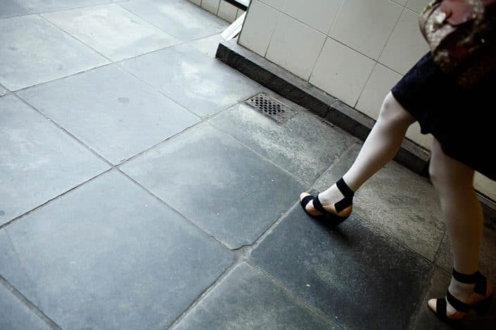 Nederland, Amsterdam, 22-06-2011 Beautiful woman legs in white nylon at Amstelstation PHOTO AND COPYRIGHT ROGER CREMERS