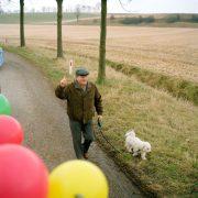 Nederland, Bingelrade, 21-02-2009 CV de Keescheknup Bengelder Carnavals optocht in Bingelrade. Man met hond groet de prins. PHOTO AND COPYRIGHT ROGER CREMERS