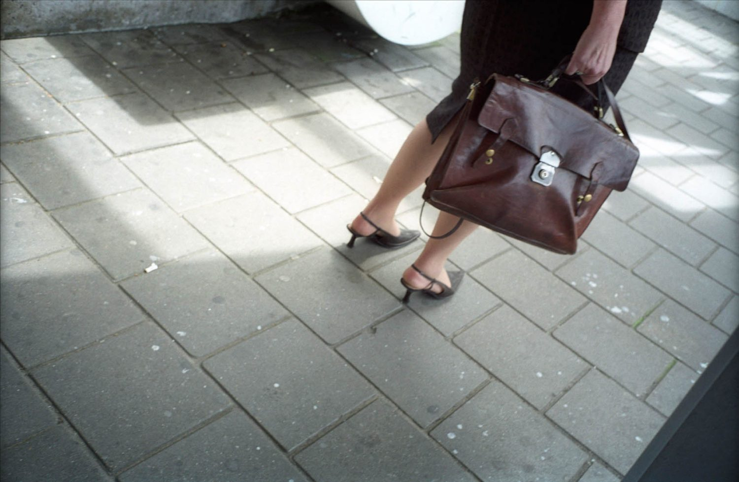 Photo and Copyright Roger Cremers 11-06-2003 Beautiful en elegant woman legs on high heels on the railway platform of Centraal Station in Leiden.