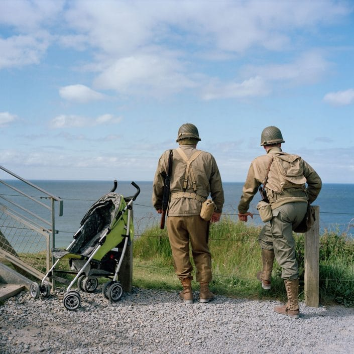 Frankrijk, Pointe Du Hoc, 03-06-2012 Two reenactors next to a baby carriage staring at the sea Among the first landing troops at Omaha Beach were also men of the 2nd battalion of American Rangers. They were at the most eastern part of Omaha Beach landing. From this place they went inland and then draw the German defenders at Pointe-du-Hoc in the back to attack. PHOTO AND COPYRIGHT ROGER CREMERS