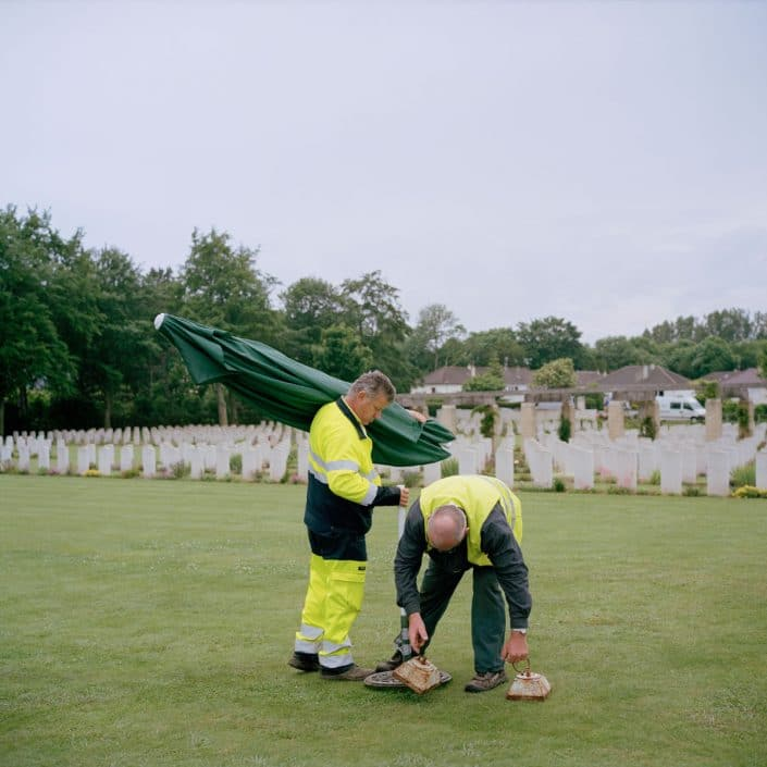 Frankrijk, Ranville, 05-06-2012 Commonwealth War Cemetery Ranville. Two city workers take a way the materials needed for a memorial PHOTO AND COPYRIGHT ROGER CREMERS