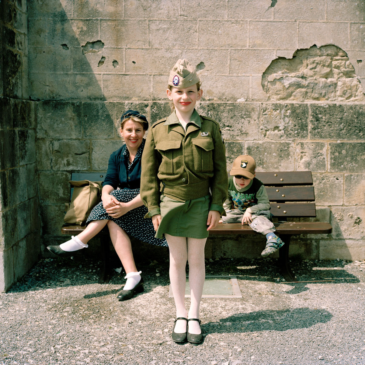 Frankrijk, Sainte-Mere-Eglise, 07-06-2013 Girl in Army clotches on the market. PHOTO AND COPYRIGHT ROGER CREMERS